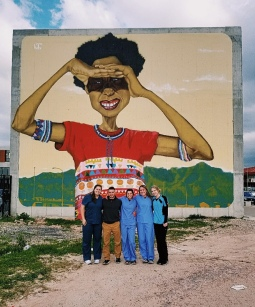 All 5 clinic interns in front of some Khayelitsha art
